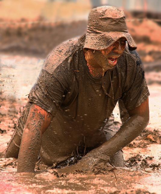 Man walking through mud