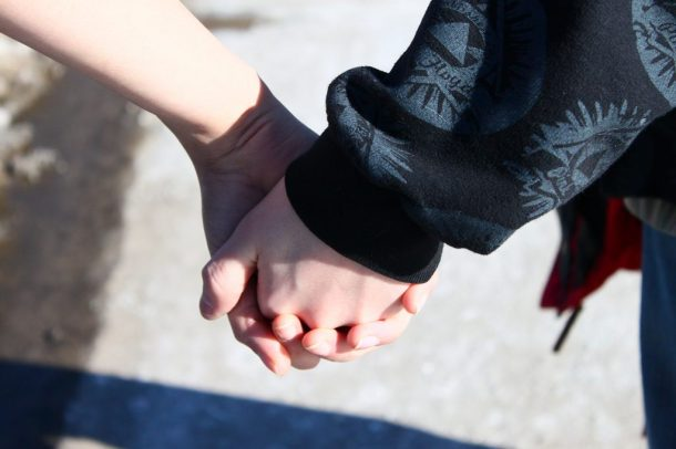 Couple Holding Hands, communication, relationship awareness, working with your partners fear, transformation, mindfulness, mindful fitness, mindfitmove