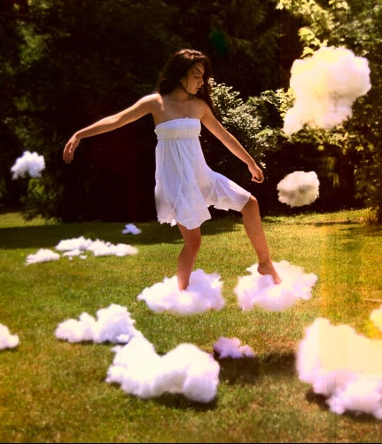 Picture of a woman walking on clouds following her heart mindfully